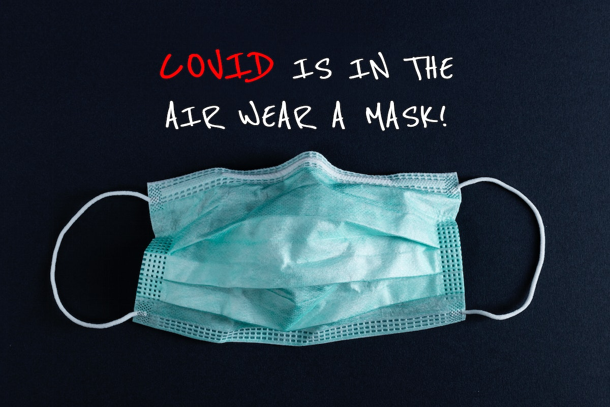 Covid is in the air, wear a mask banner