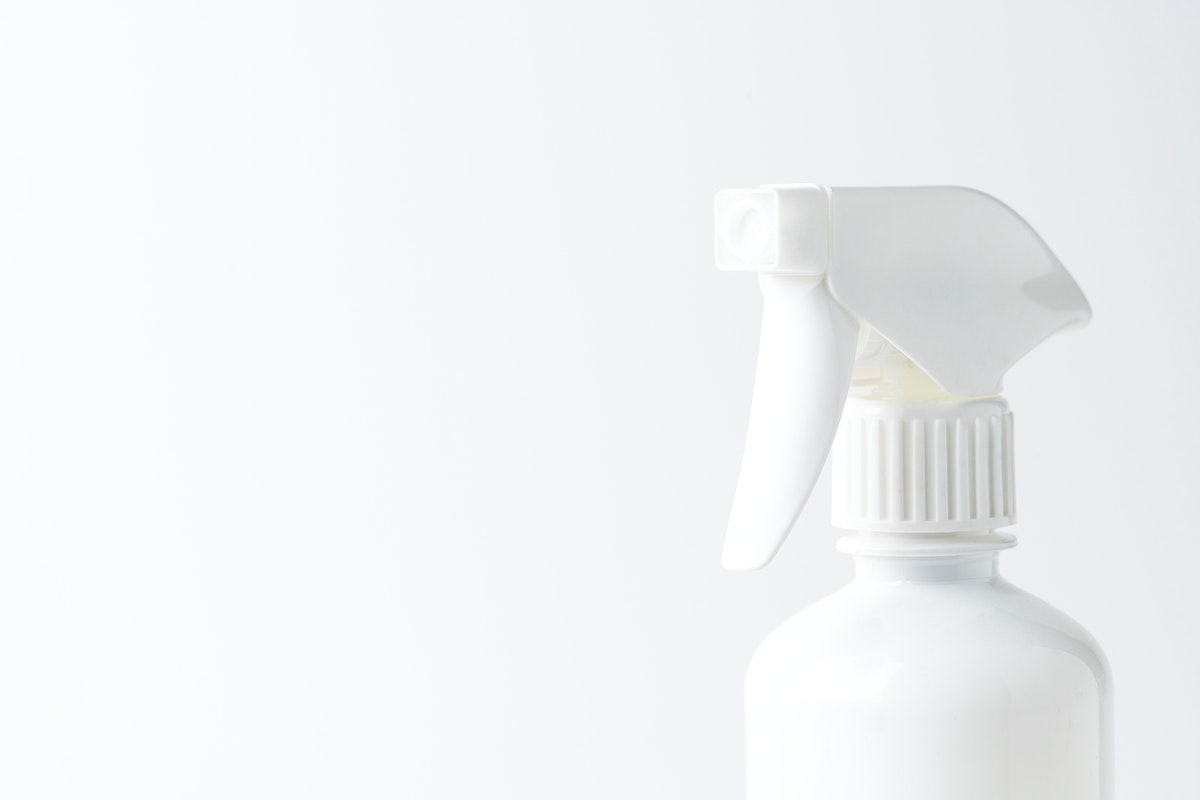 White spray bottle on a plain background
