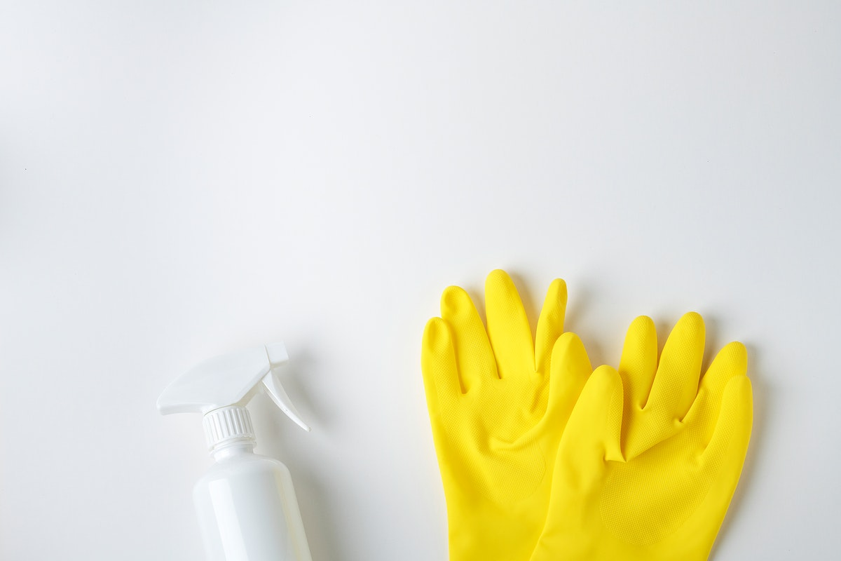 Yellow gloves and a white spray bottle