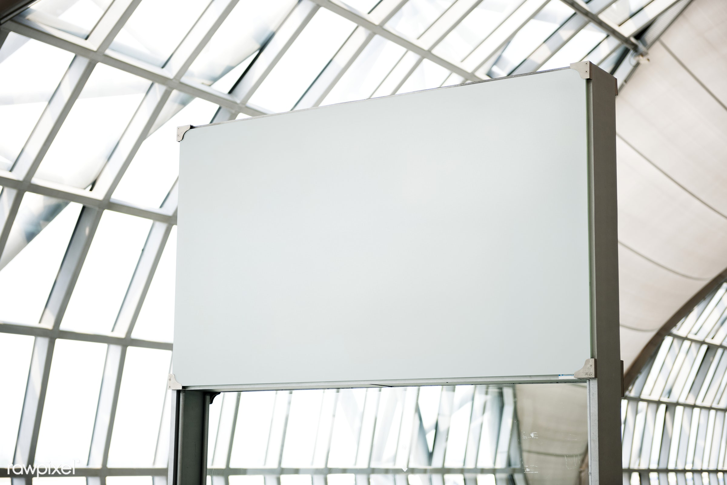 White blank billboard at an airport - advertising, banner, ad, advert, announcement, billboard, blank, board, copy space,...