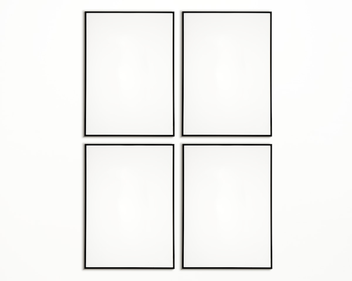Four photo frames isolated on white wall