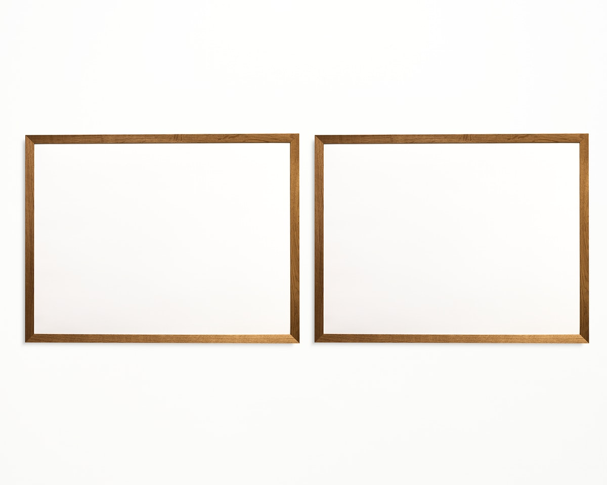 Two photo frames isolated on white wall