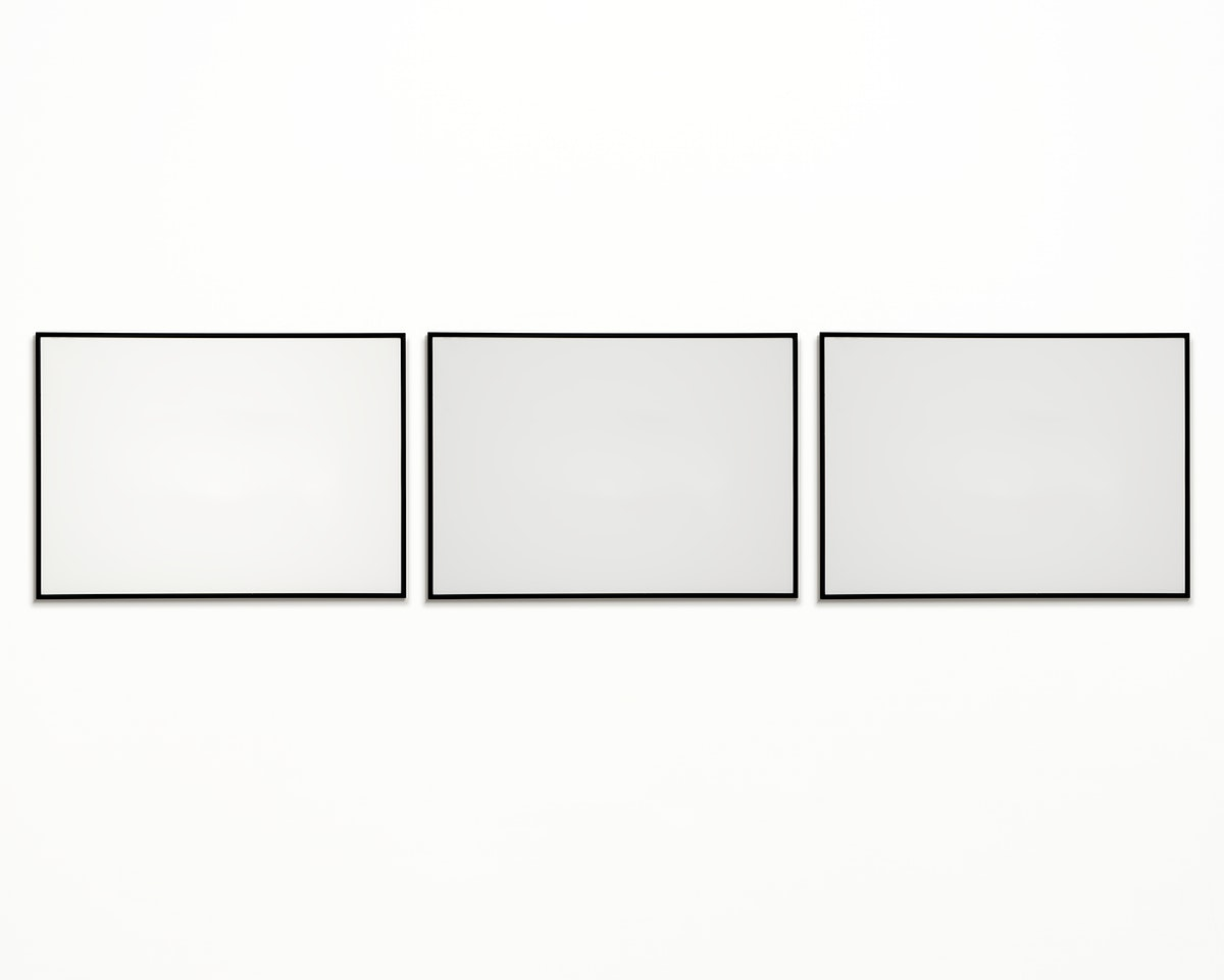 Three photo frames isolated on white wall