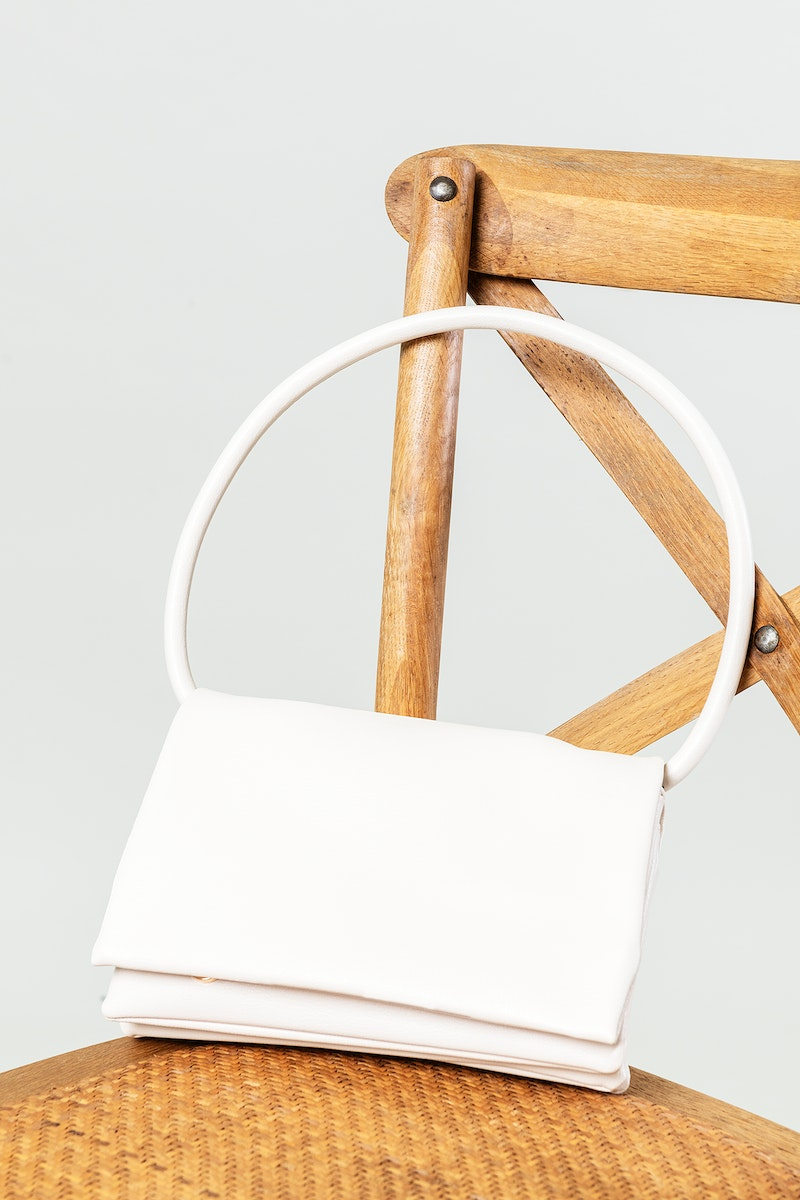 A while hand bag on a chair