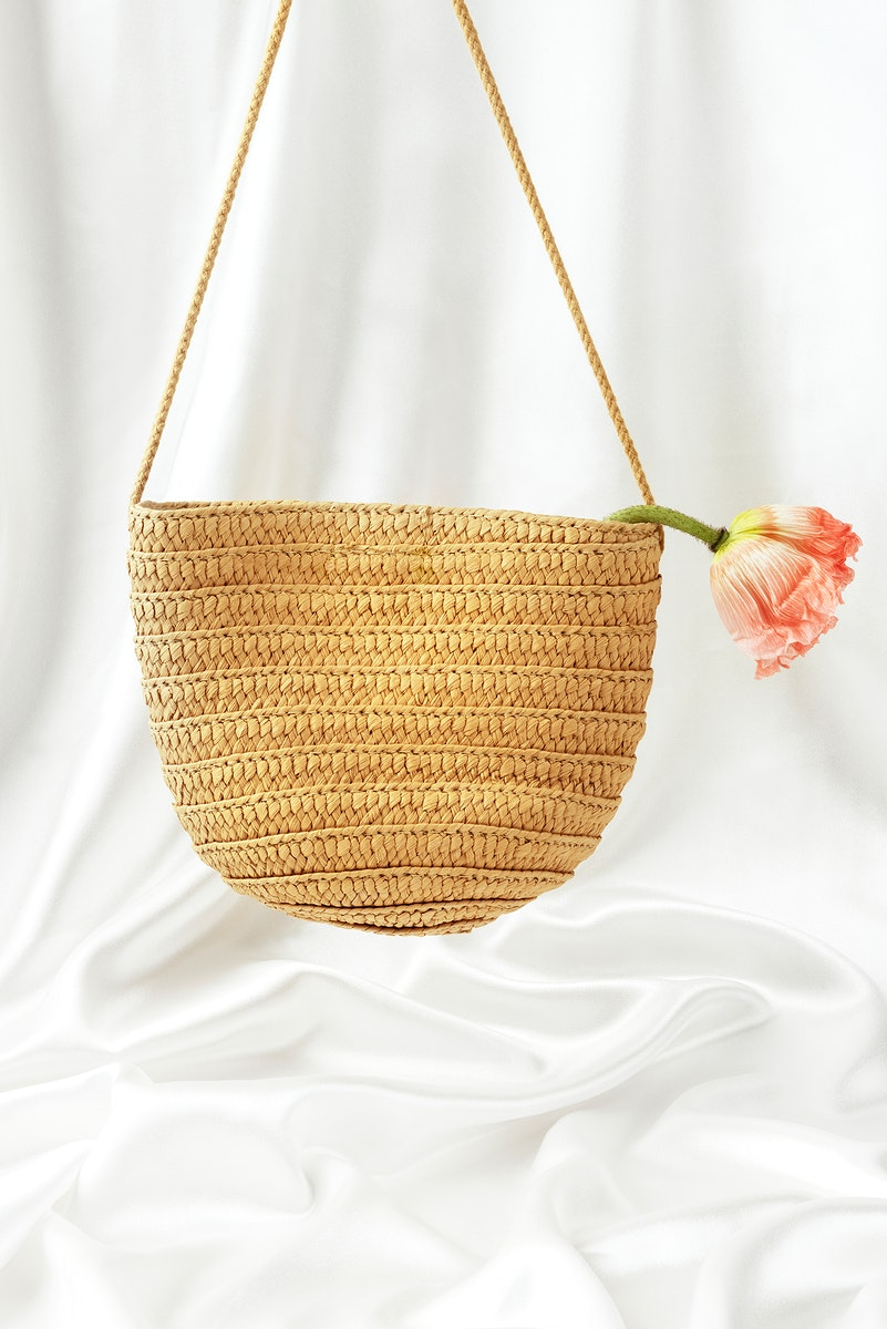 Straw woven bag mockup with a flower