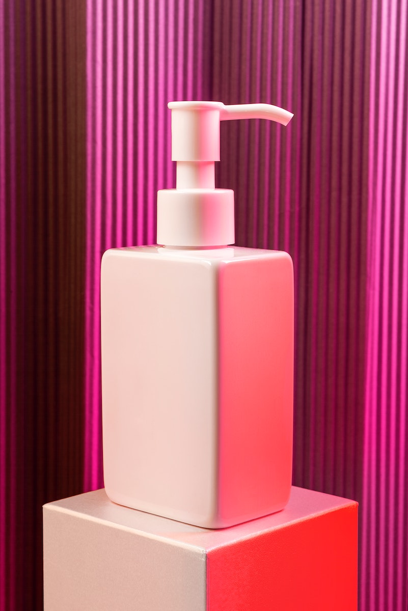 Blank white pump bottle with pink neon light mockup