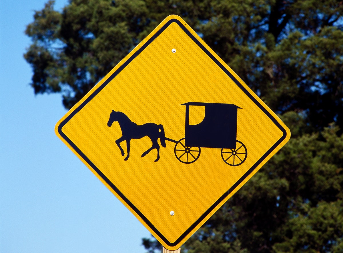 A caution sign to auto drivers to be on the lookout for Amish horses and buggies. Original image from Carol M.…