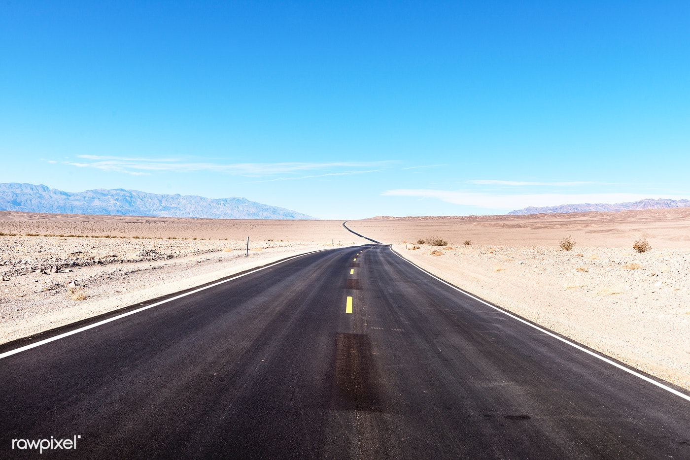 One of many long, straight, black roads in California's Death Valley. Original image from Carol M. Highsmith's...