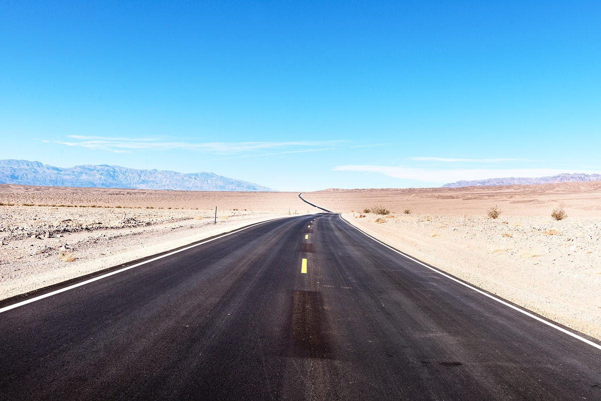 One of many long, straight, black roads in California's Death Valley. Original image from Carol M. Highsmith's America…
