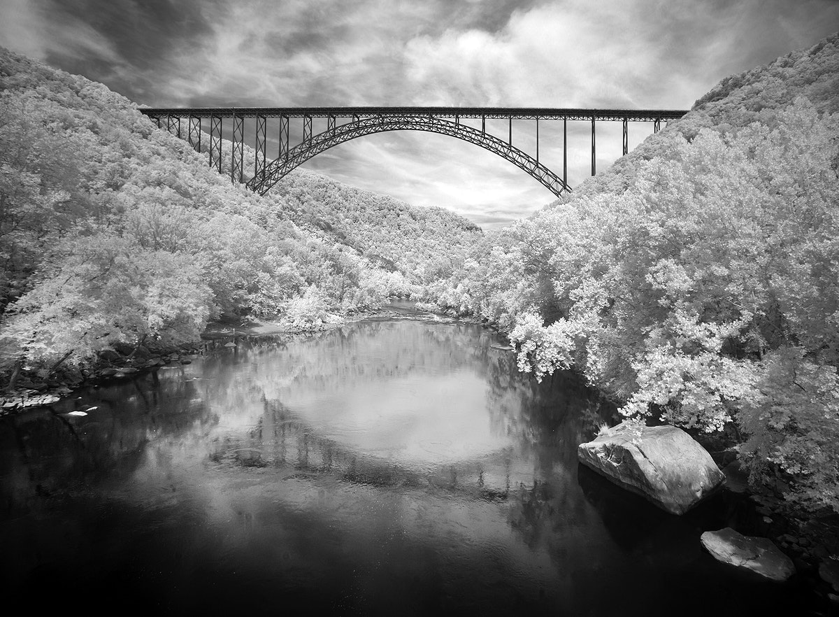 Infrared-camera view of the New River Gorge Bridge in Fayette County, West Virginia. Original image from Carol M.…