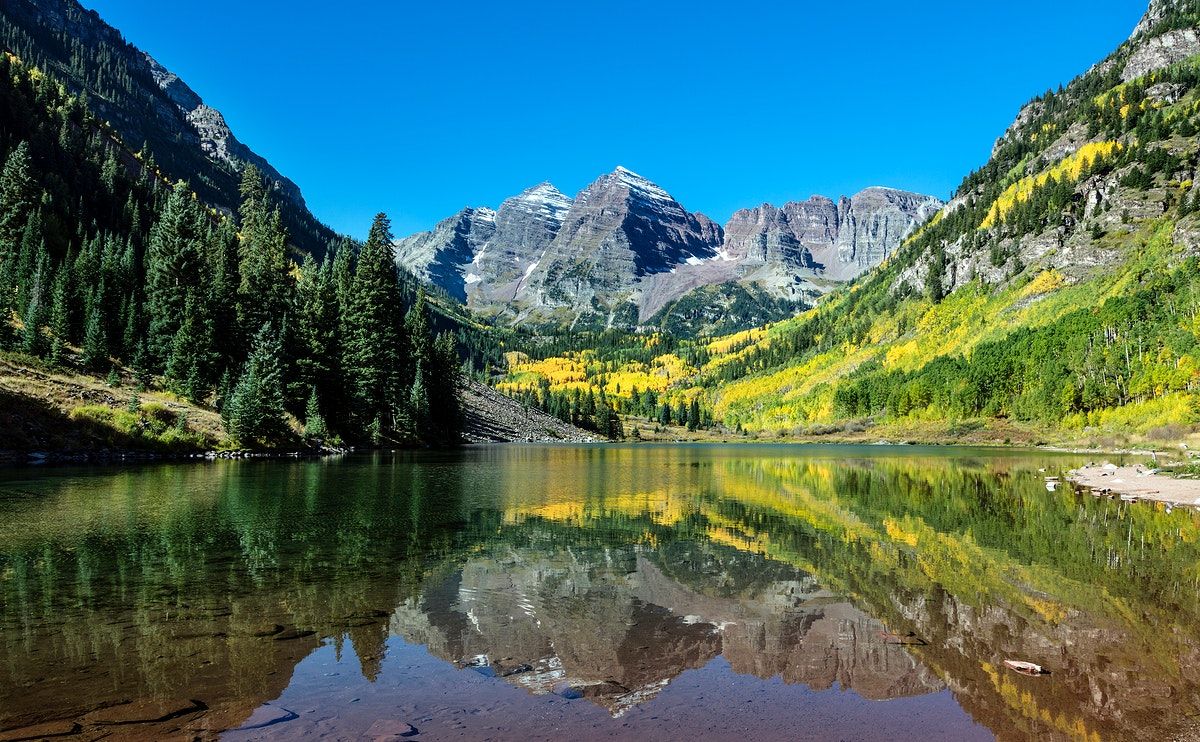 Autumnal view of Rocky Mountain peaks called the Maroon Bells, between Pitkin County and Gunnison County, Colorado. Original…