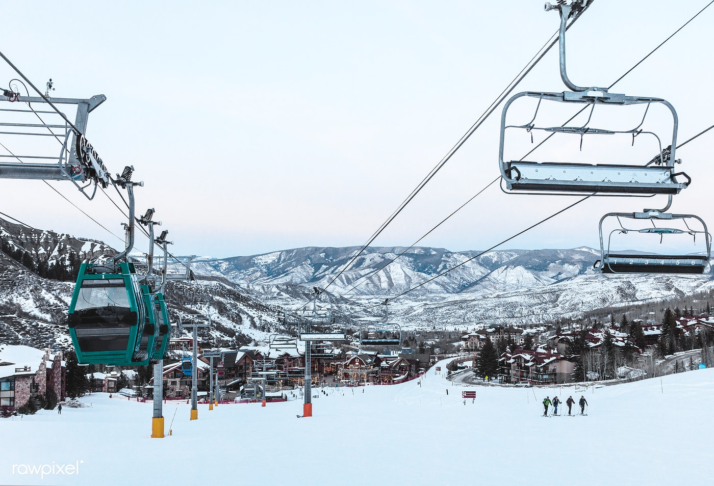 Chairlifts ascend the mountain at the Snowmass Village ski resort in Pitkin County, Colorado - Original image from Carol M....