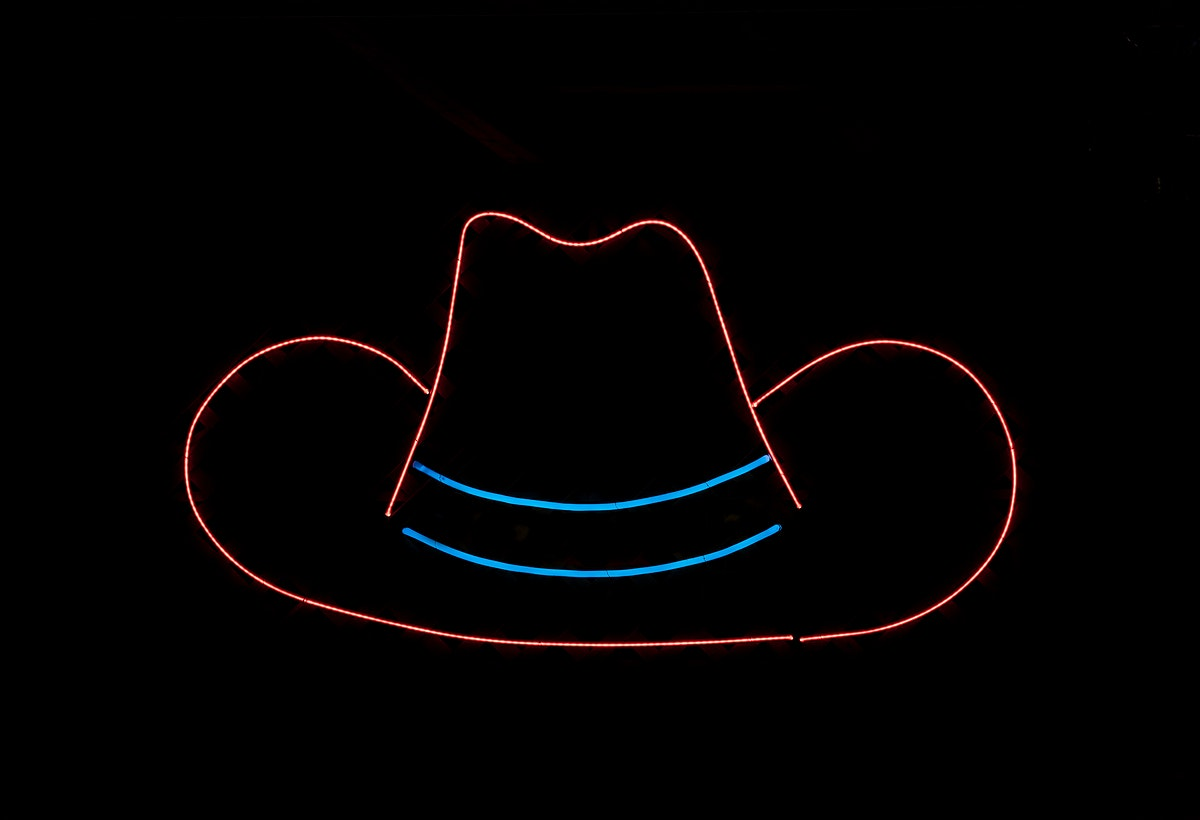 Cowboy-hat neon in a food tent at the Iowa State Fair in the capital city of Des Moines. Original image from Carol M.…