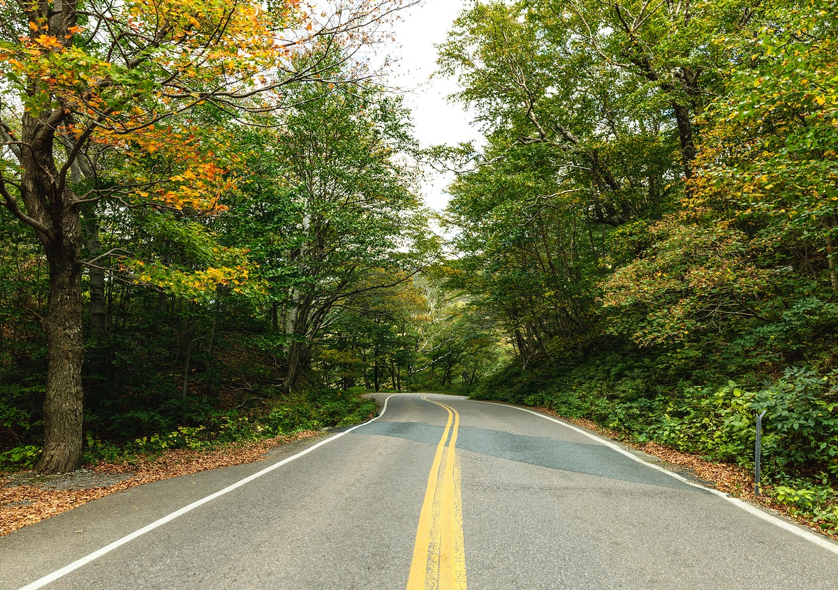 Road through Smugglers' Notch, a narrow mountain pass surrounded by high bluffs in Lamoille County, Vermont. Original image…