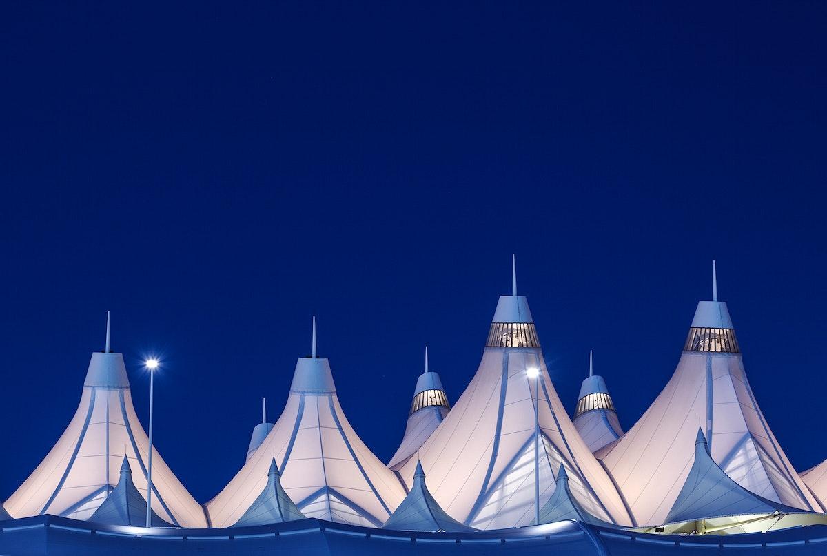 Denver International Airport's peaked roof, outside Denver, Colorado, designed by Fentress Bradburn Architects.Original image…