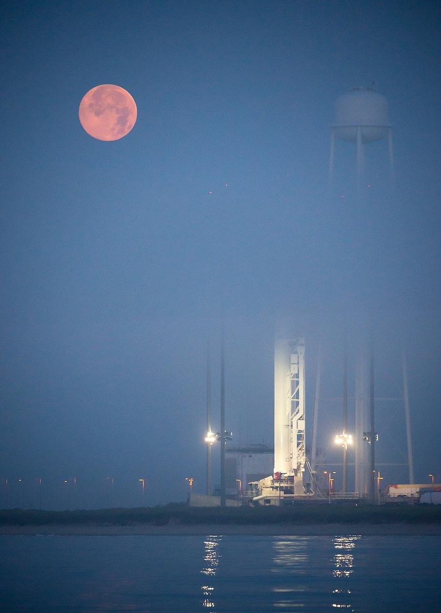 The full Moon sets in the fog behind the Orbital Sciences Corporation Antares rocket. Original from NASA. Digitally enhanced…