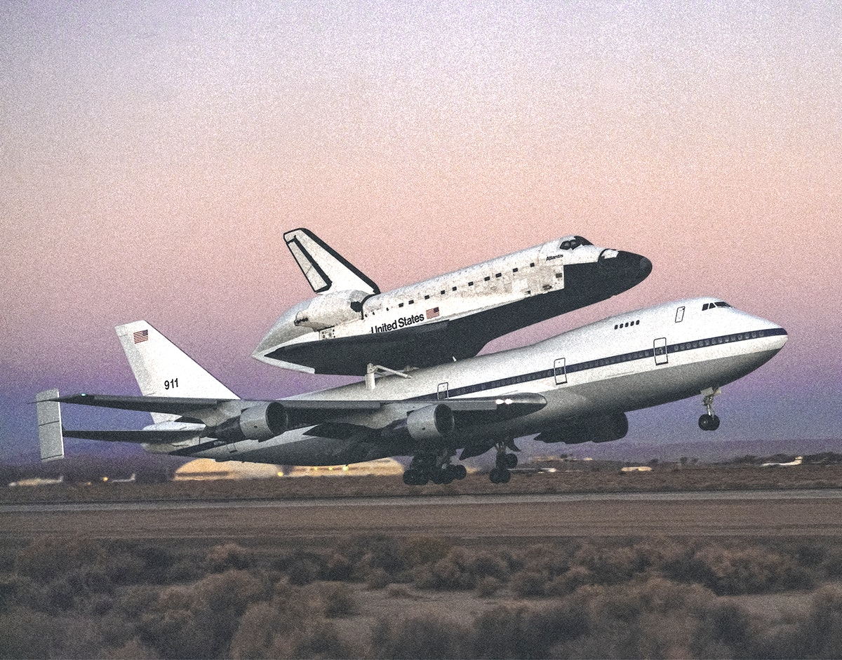 The space shuttle Atlantis atop NASA's 747 Shuttle Carrier Aircraft (SCA) during takeoff for a return ferry flight to the…