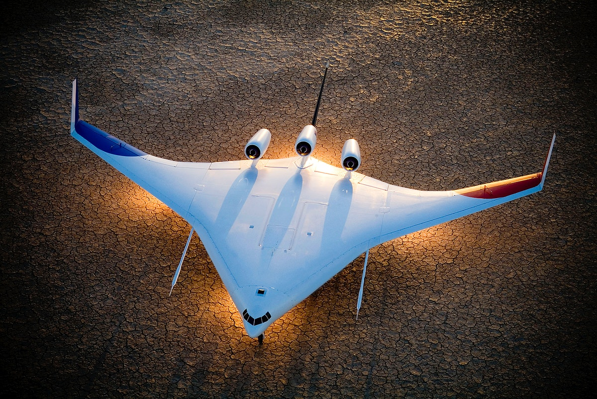 Boeing's X-48B Blended Wing Body technology demonstrator shows off its unique lines at sunset on Rogers Dry Lake adjacent to…