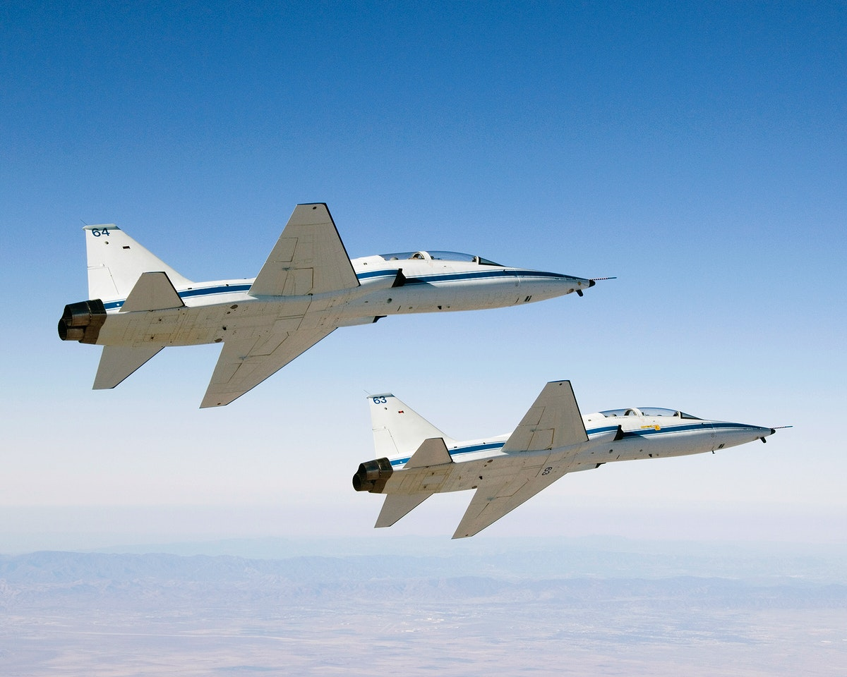 NASA Dryden's two T-38A mission support aircraft fly in tight formation, Sept 26th, 2007. Original from NASA. Digitally…