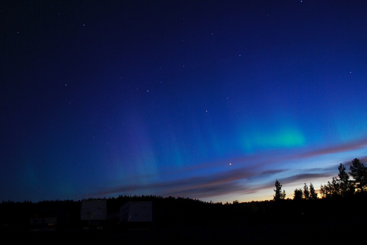 NASA's BARREL Mission in Sweden. The faint green glow of aurora can be seen above the clouds at Esrange Space Center in this…