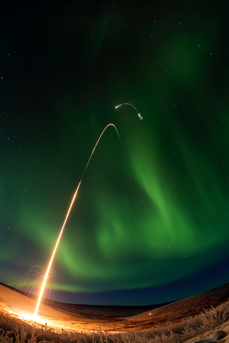 Sounding rocket launches successfully from Alaska and a green aurora dancing over Alaska. All four stages of the rocket are…