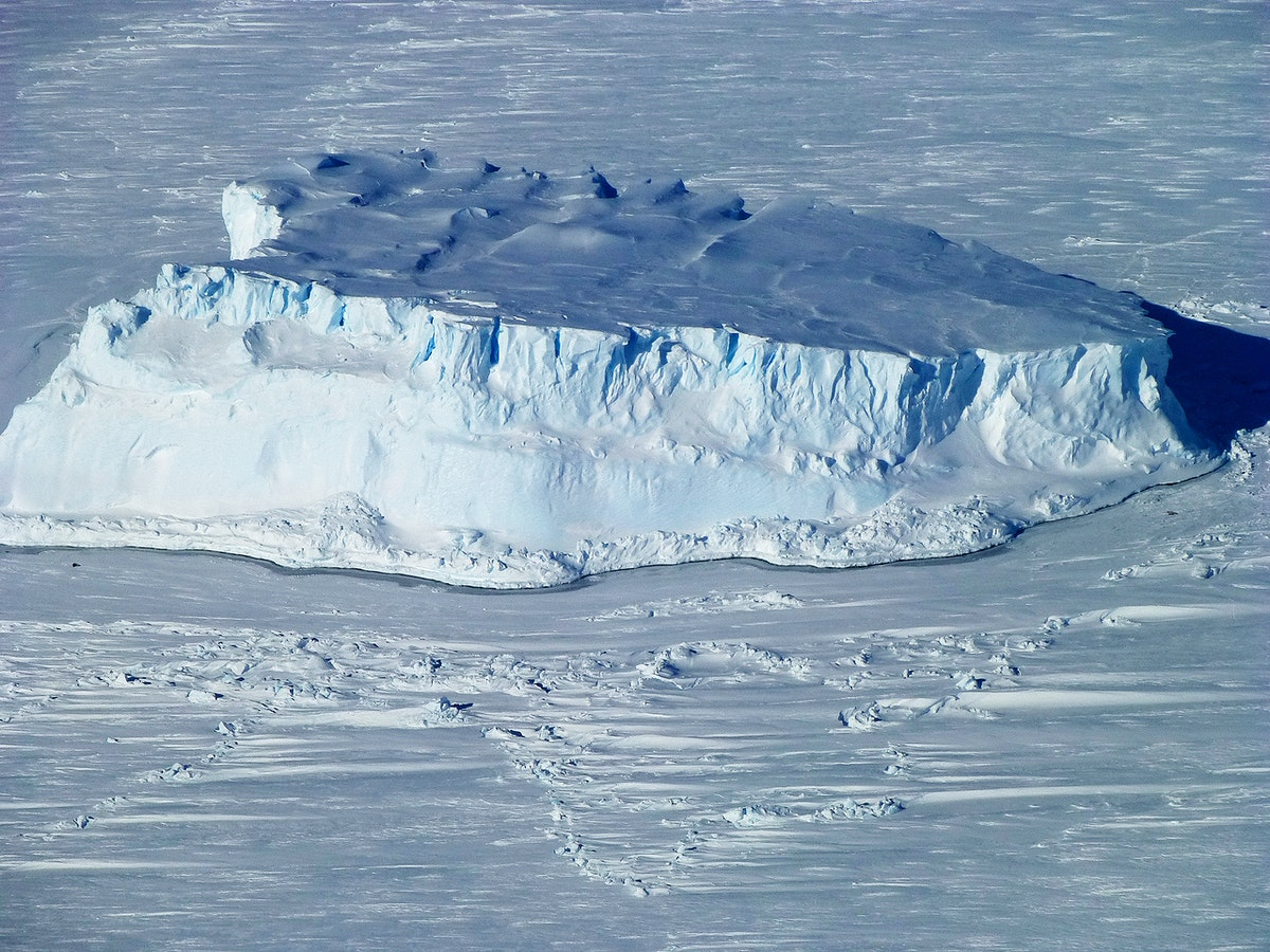 An iceberg trapped in sea ice in the Amundsen Sea. Original from NASA. Digitally enhanced by rawpixel.