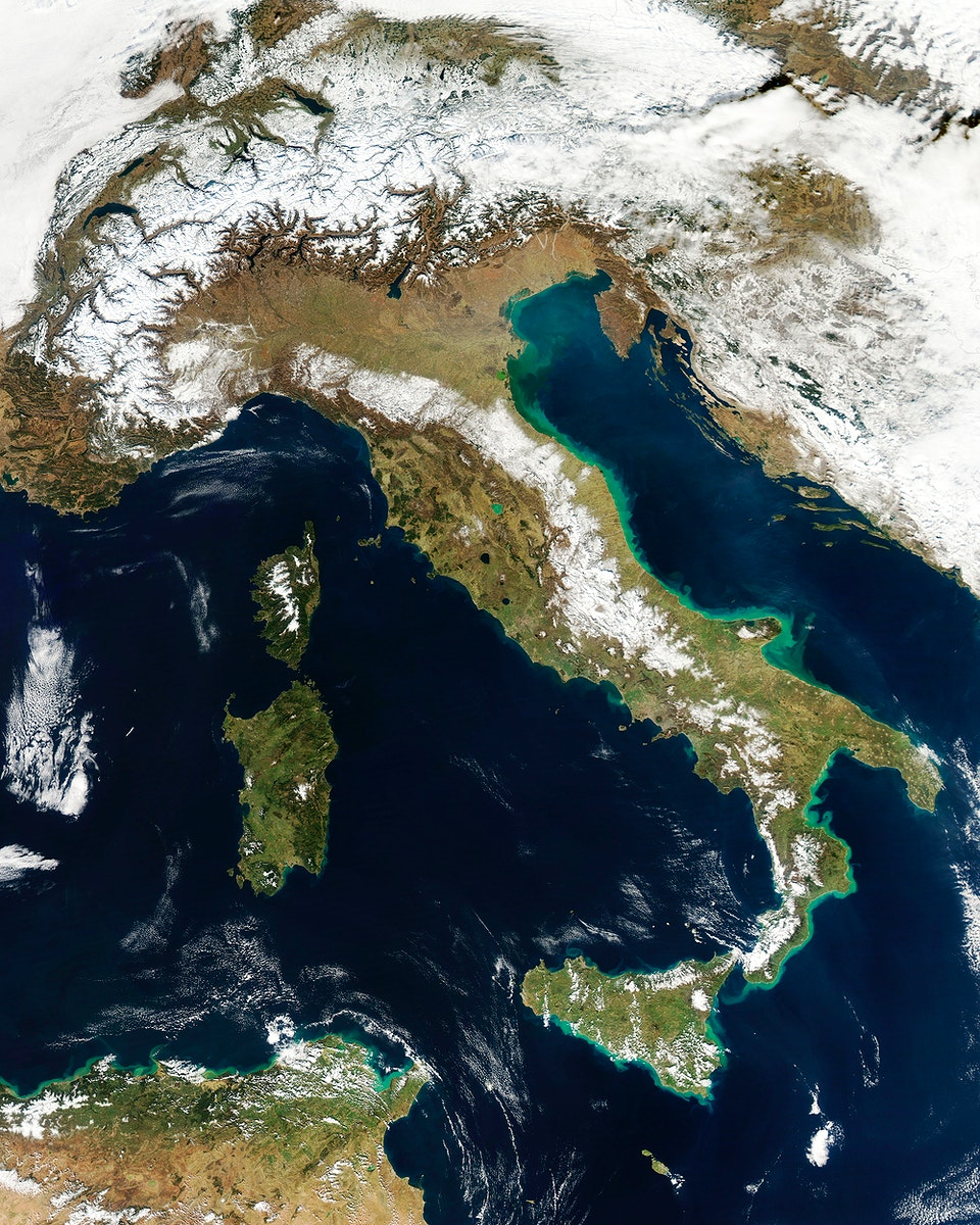 Snow, which tends to be generally less bright that clouds, covers the Alps in the north of Italy. Original from NASA.…