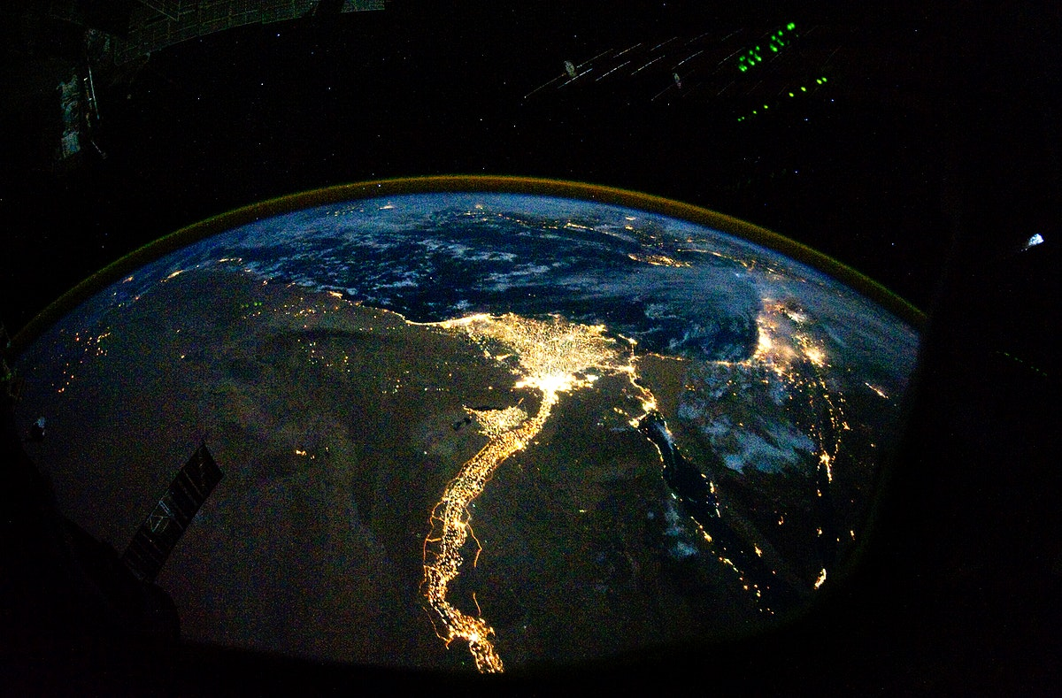 Night time photo featuring the bright lights of Cairo and Alexandria, Egypt on the Mediterranean coast. The Sinai Peninsula…