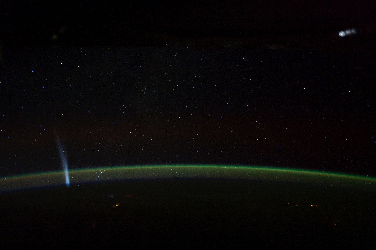 Comet Lovejoy is visible near Earth's horizon in this nighttime image photographed by NASA. Original from NASA.…