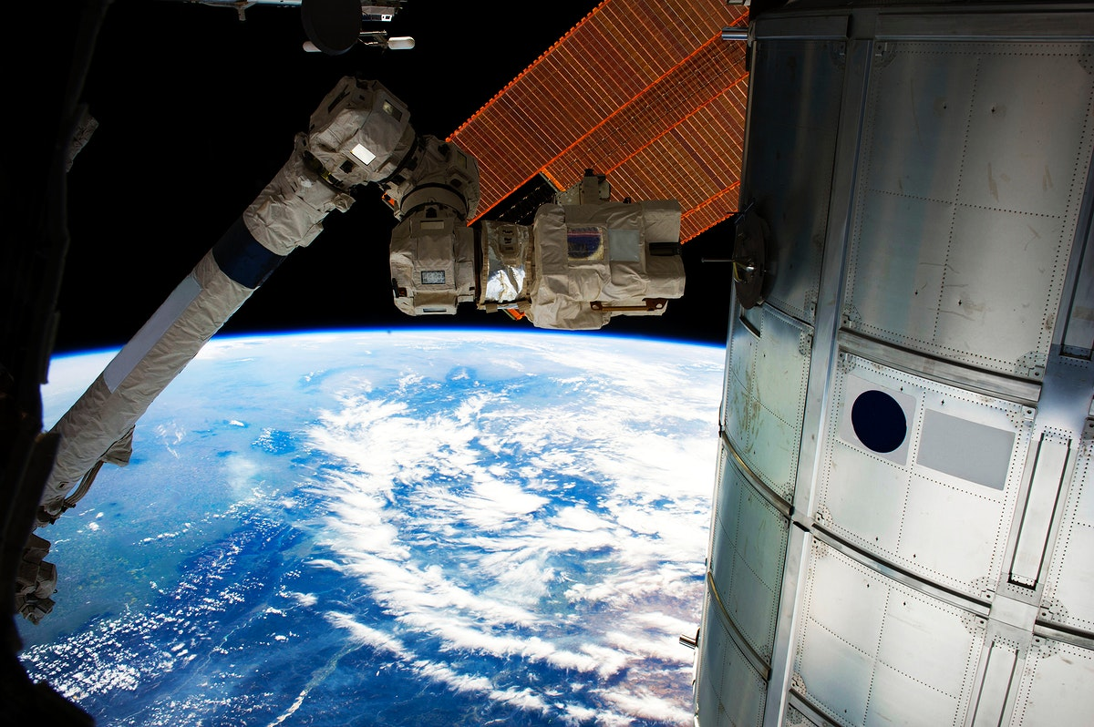 SSRMS test grapple 1: The Canadarm2 photographed by an Expedition 40 crew member on the International Space Station. July…