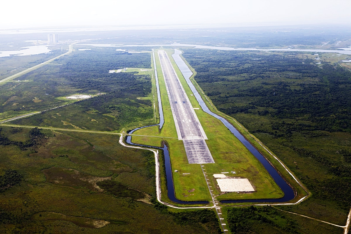 This aerial view shows the 15,000-foot long Shuttle Landing Facility at the Kennedy Space Center, Fla. Original from NASA.…