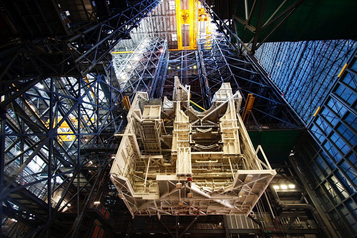 A large space shuttle-era work platform is being lowered and removed from high bay 3 of the Vehicle Assembly Building.…