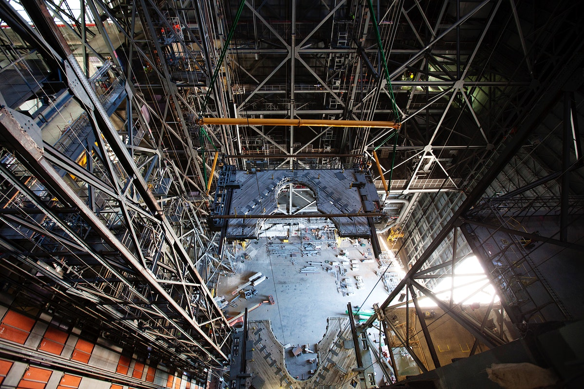 A 250-ton crane is used to lower the second half of the K-level work platforms for NASA's Space Launch System (SLS)…