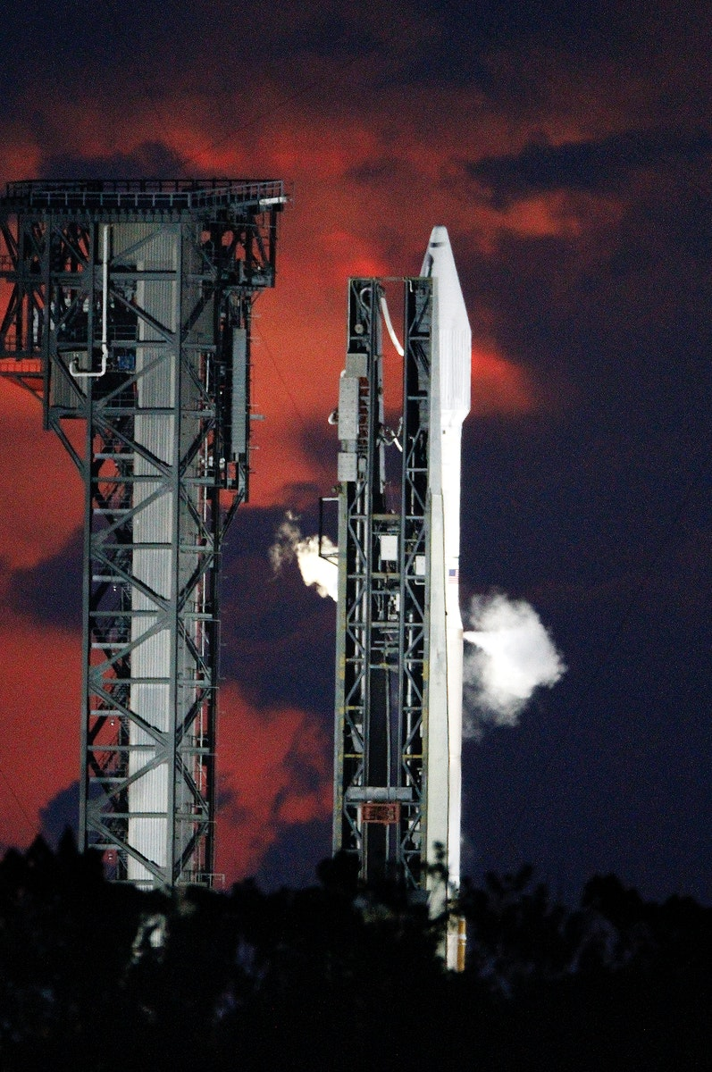 A United Launch Alliance Atlas V rocket vents liquid oxygen propellant vapors during fueling for the lift off of NASA's…