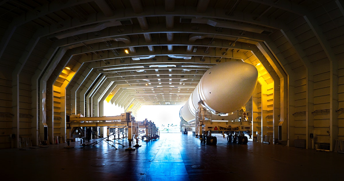 A United Launch Alliance Delta IV Heavy common booster core is about to be offloaded from the company's Mariner ship at Port…
