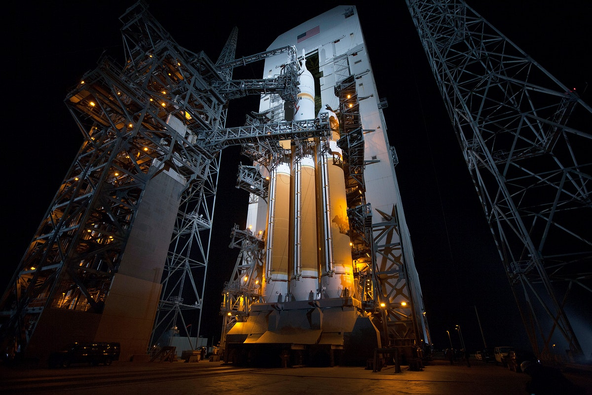 The launch gantry is rolled back to reveal NASA's Orion spacecraft mounted atop a United Launch Alliance Delta IV Heavy…