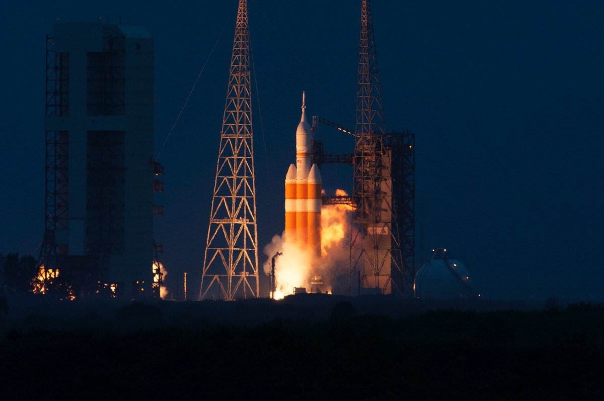 A Delta IV Heavy rocket roars to life at Space Launch Complex 37 at Cape Canaveral Air Force Station in Florida. Original…