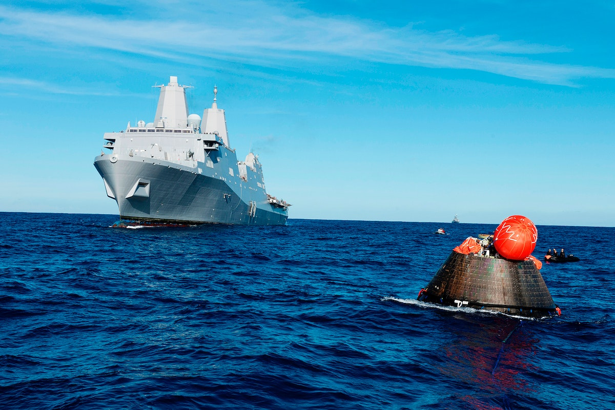 NASA's Orion spacecraft floats in the Pacific Ocean after splashdown from its first flight test in Earth orbit. Original from…