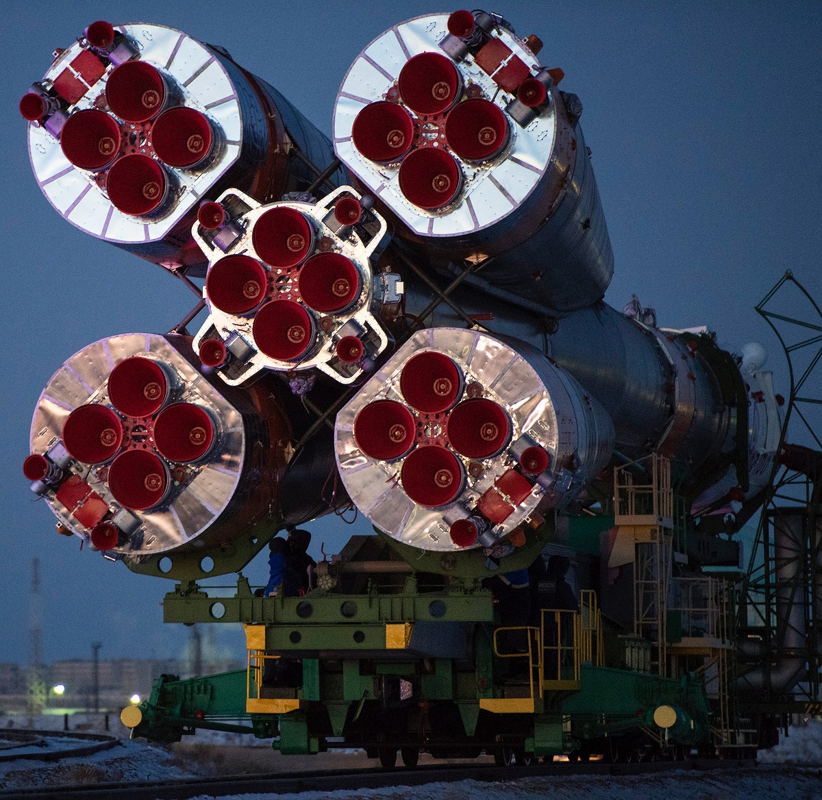 The Soyuz rocket is rolled out by train to the launch pad, Friday, Dec. 15, 2017. Original from NASA. Digitally enhanced by…