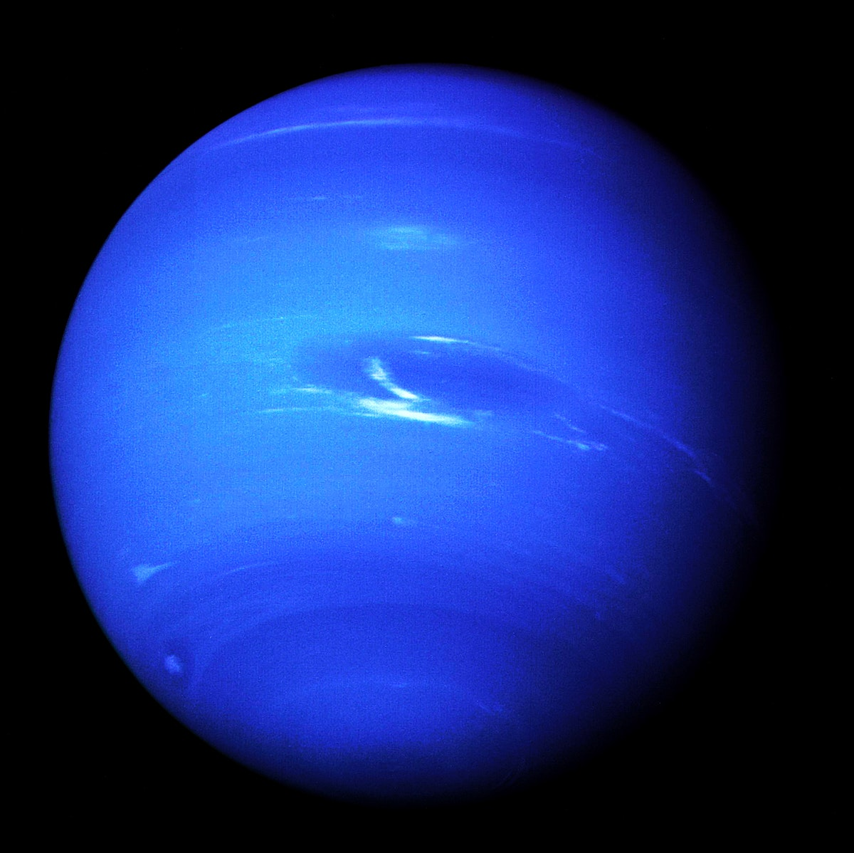 This picture of Neptune was produced from the last whole planet images taken through the green and orange filters on NASA's…