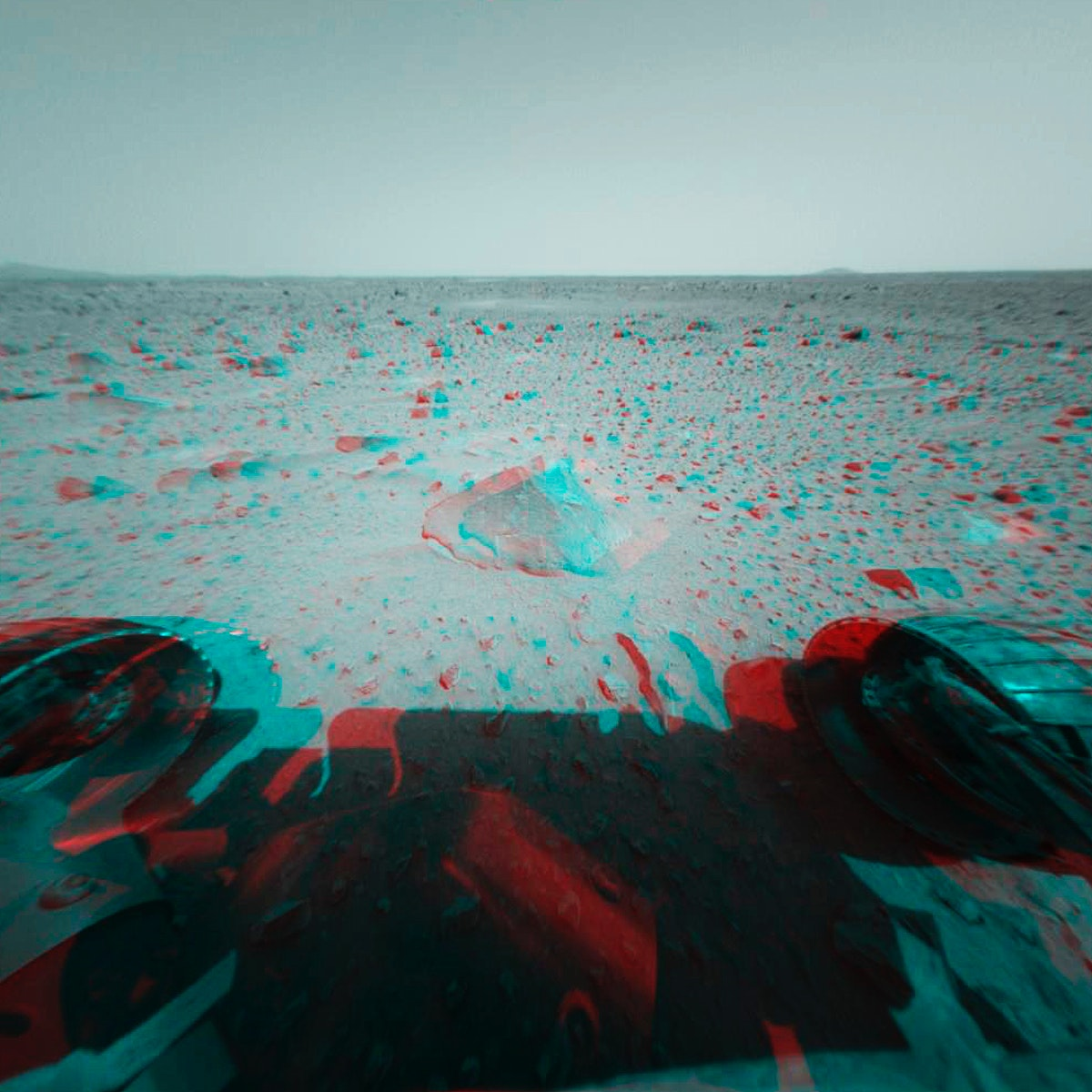This 3-D stereo anaglyph image was taken by NASA's Mars Exploration Rover Spirit. 3D glasses are necessary to view this…