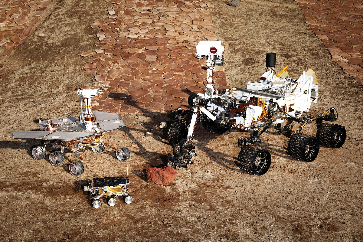 This grouping of two test rovers and a flight spare provides a graphic comparison of three generations of Mars rovers…