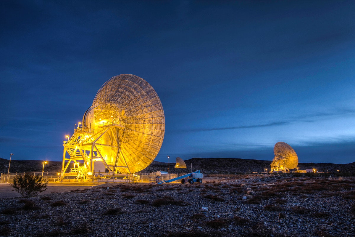 Beam Wave Guide antennas at Goldstone, known as the Beam Waveguide Cluster. Original from NASA. Digitally enhanced by…