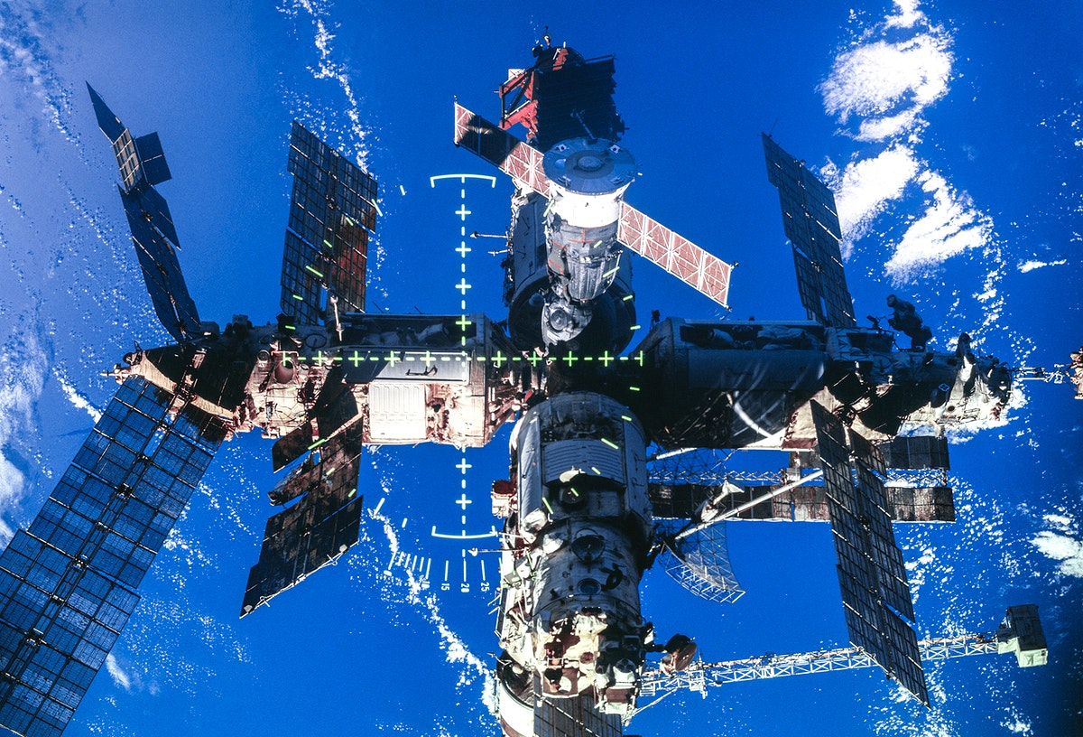 Full views of Mir Space Station after undocking during flyaround. Original from NASA . Digitally enhanced by rawpixel.