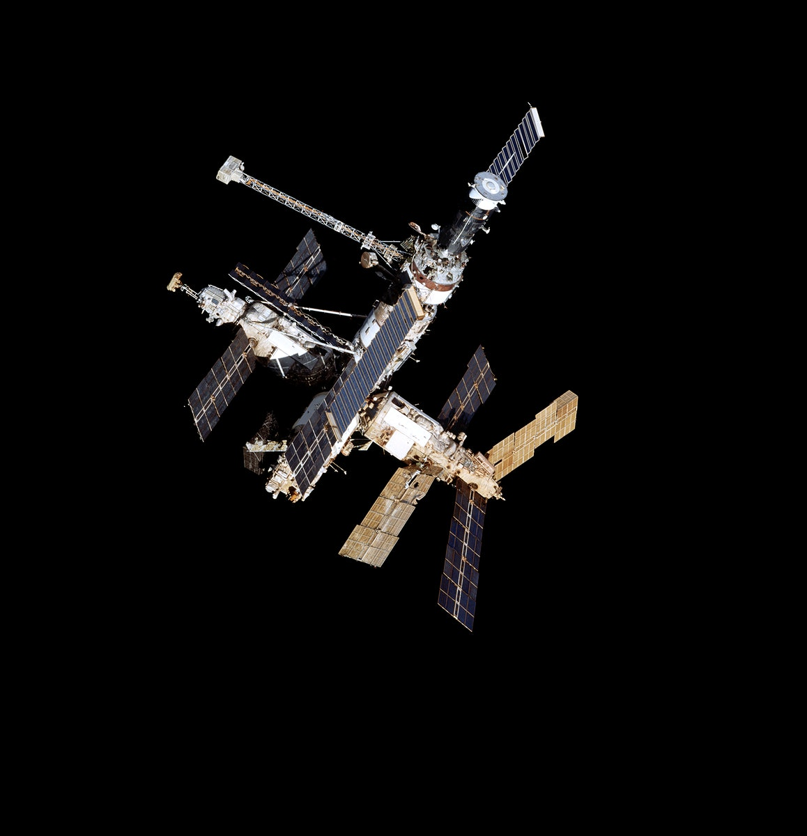 Full views of Mir Space Station after undocking during flyaround. Original from NASA. Digitally enhanced by rawpixel.
