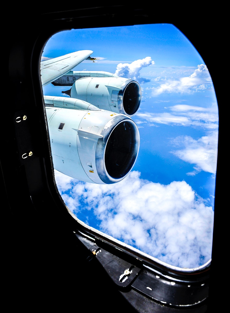 Cloud formations are seen through the window of NASA DC-8 aircraft during a flight over the Gulf of Mexico, Aug. 17, 2010.…