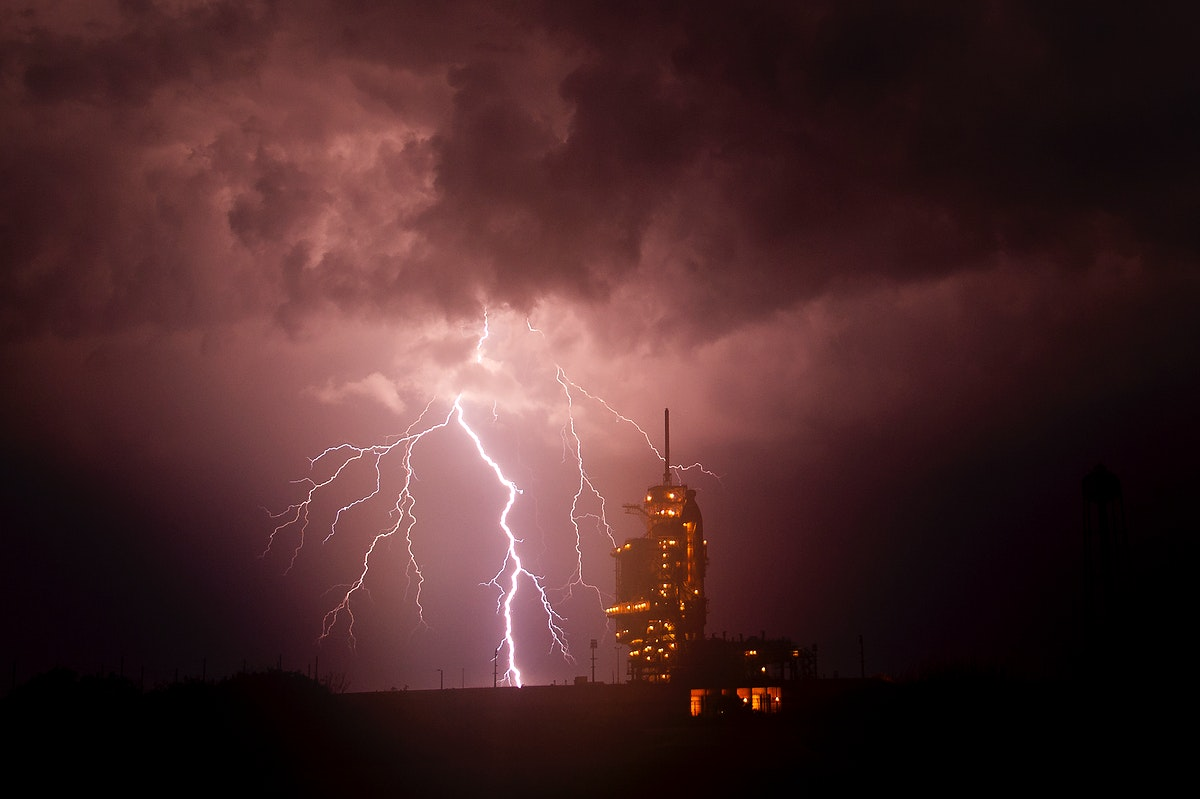 The Endeavour at launch pad 39a as a storm passes by prior to the rollback of the Rotating Service Structure, April 28, 2011.…