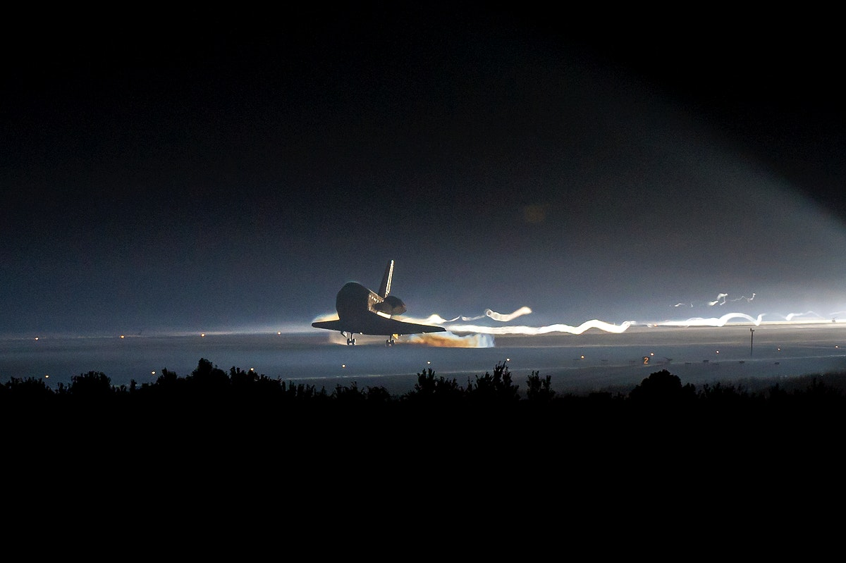Space shuttle Atlantis touches down at NASA's Kennedy Space Center Shuttle Landing Facility completing its 13-day mission to…