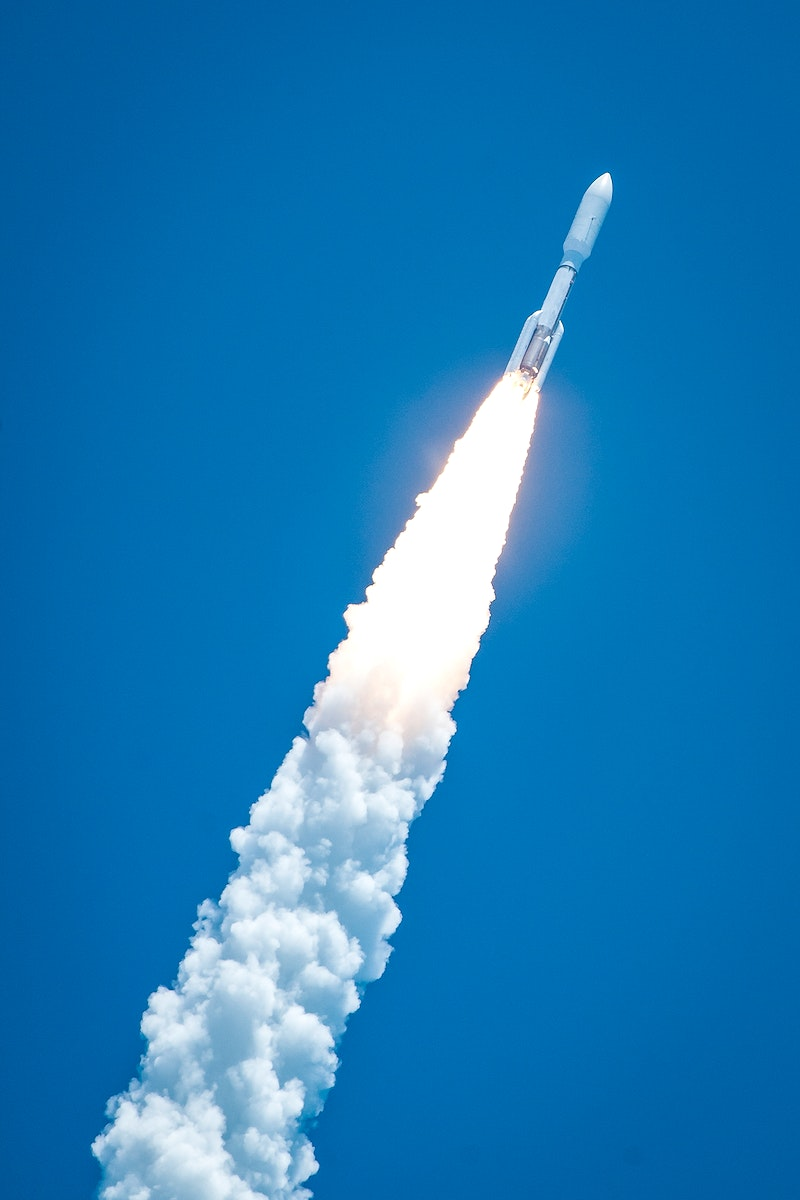 Rising from fire and smoke, NASA's Juno planetary probe, enclosed in its payload fairing, launches atop a United Launch…