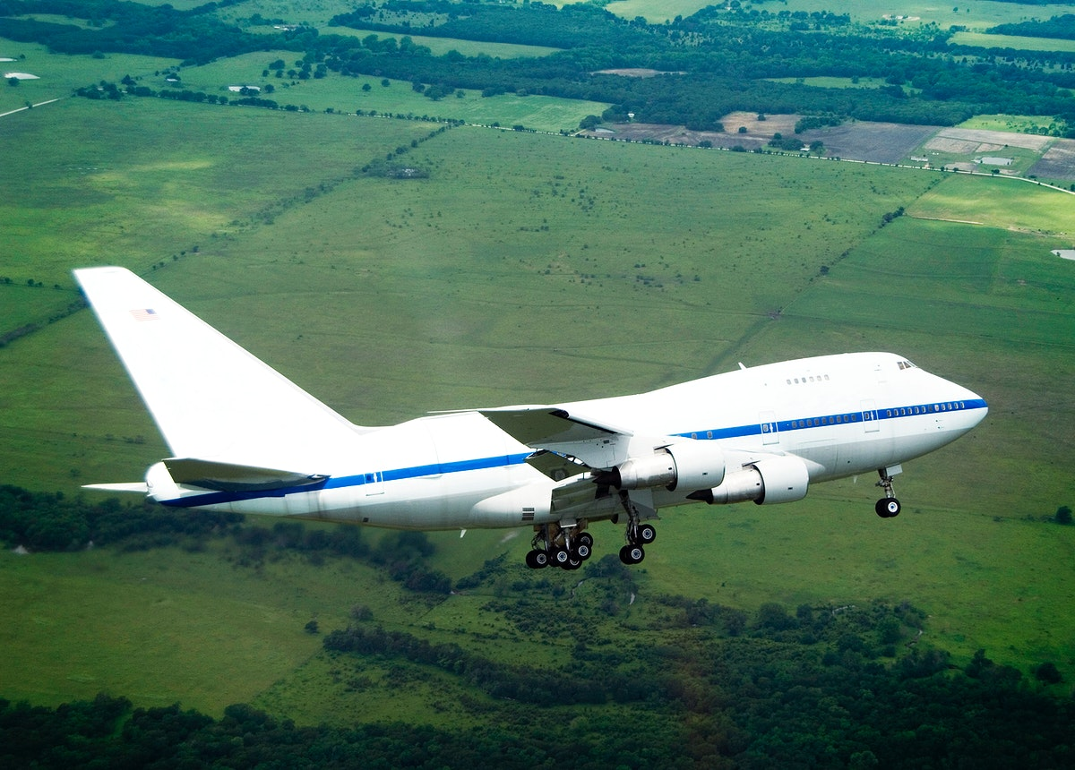 NASA's highly modified Boeing 747SP SOFIA observatory banks low over the Texas countryside as it heads for landing at Waco to…